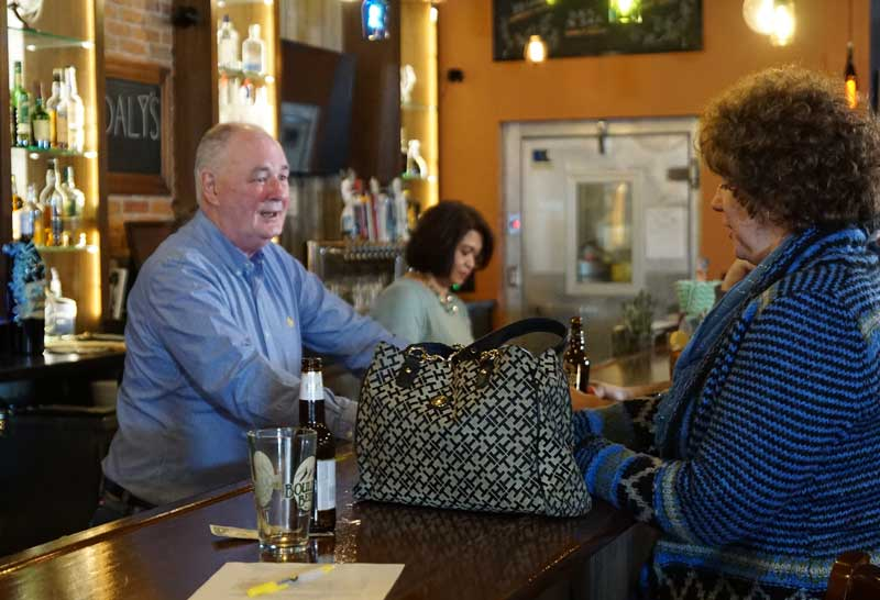 Jim Daly, Owner of Daly's Restaurant in Wausau, WI, serving a customer